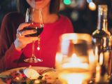 woman holding wine glass selective focus photography
